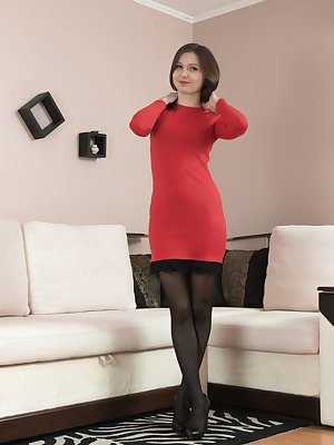Slava Sanina has on her new red dress, and strips it off with her black stockings on her white couch.. She lays naked on the couch, shows her hairy bush off, and tugs on her pussy lips with a smile.
