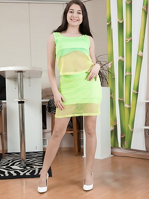 Bellavitana is showing off her body in her yellow dress and green lingerie. She strips it all off, and we see her C cup breasts and very hairy pits and pussy. She has a sexy natural body to see and love.