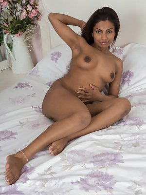 Alishaa Mae is in her purple lingerie in her bedroom. She strips naked and we enjoy her hairy pussy and sexy figure. She lays back, opens up her legs, and watches us see her pink pussy lips shine.