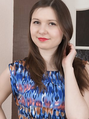 Slava Sanina is wearing a new blue dress and showing it off today. She takes it off and her white lingerie, and shows her natural figure. She lays on the bed, spreads her legs and has a hairy bush.