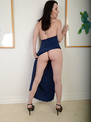 Middle-aged brunette woman RayVeness slips off her long dress for nude posing