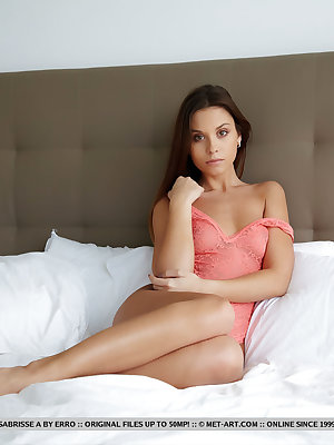 Teen glamour model Sabrisse A undresses for nude posing on her bed