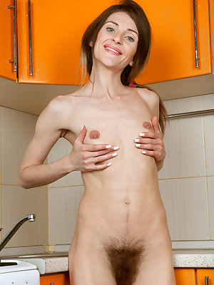 Skinny chick Olivia Arden flaunting super thin body & hairy pussy in kitchen