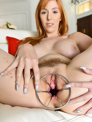 Hot redhead with nice boobs and tattoos pleasures her trimmed bush