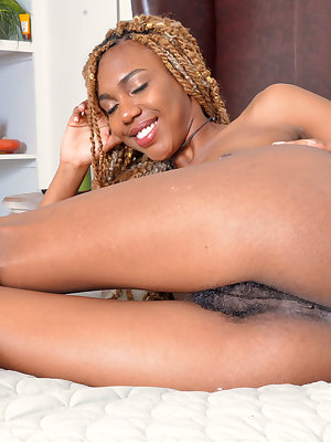 Long legged black female Kimmy Katt is all smiles while posing nude