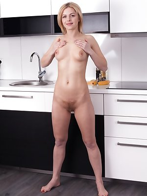 Sexy blonde Ayda undressing in the kitchen to spread pussy lips close up