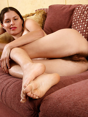 Older lady Kristina shows off her hirsute body in the nude on her couch