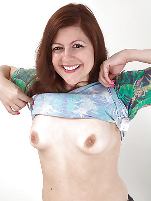 Mature woman Lacey flashing small breasts before unveiling all natural vagina
