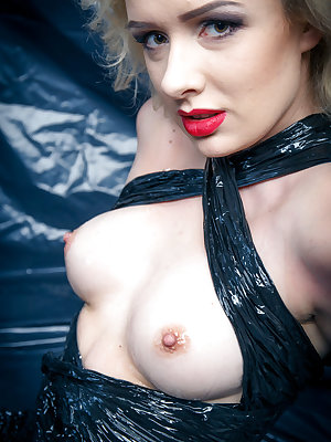 Hot blonde Lucia wrapped in plastic with big tits bared spreads oiled twat