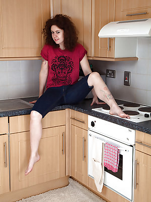 Older brunette solo model Candy unveiling all natural pussy in kitchen