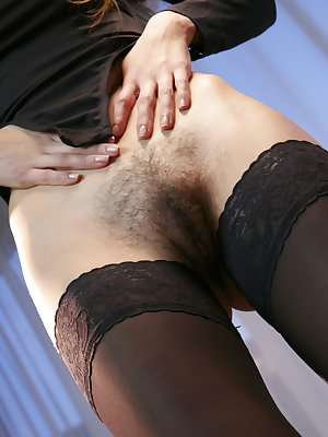 Sexy Zavya in stockings and bodysuit showing off a very hairy snatch