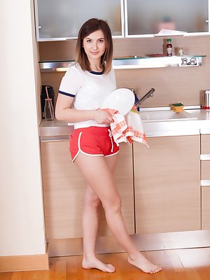 Brunette Vanata peels her shorts in the kitchen for very hairy muff closeup