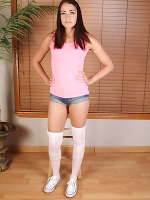 Amateur girl showcases her hairy teen pussy wearing over the knee socks