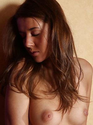 Young brunette girl Sybil A opens her legs to best display her trimmed muff