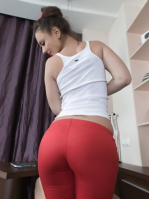 Dea Ishtar is relaxing in her white blouse and red pants. She strips and shows us her hairy pussy under her red panties. She climbs on her counter, shows her hairy bush and smiles as she poses with glee.