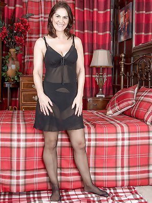 Kaysy is 52, and an English mature natural beauty. She strips off her black lingerie and stockings in her red plaid bedroom. She squeezes her 34D breasts and fondles her hairy pussy with sheer pleasure.