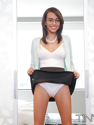 Teen secretary Janice Griffith is encouraged to get naked atop her office desk