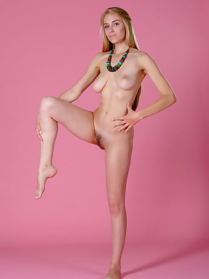 Nude young girl with long legs showcases her all natural pussy and firm tits
