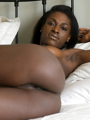 Beautiful ebony babe Aubrey A is more than comfortable lounging naked