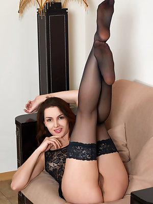 Slender brunette Joanna A doffs lace lingerie to spread legs & show hairy muff
