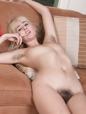 Young blonde girl Aali Rousseau stretches her hairy pussy wide open
