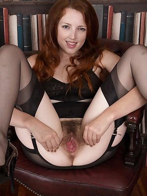 Classy rich girl Jenny Smith gives a good view of her hairy pussy in the study