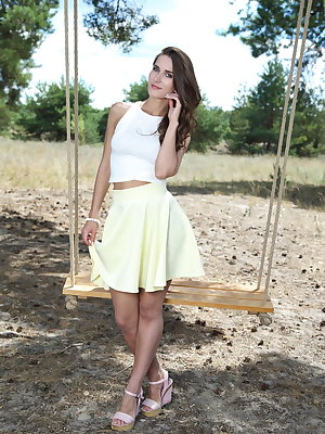 Nice teen girl shows off her freshly trimmed muff on a wooden swing out back
