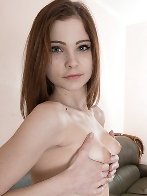 Sweet young Emanuelle looks innocent until she spreads her hairy pussy