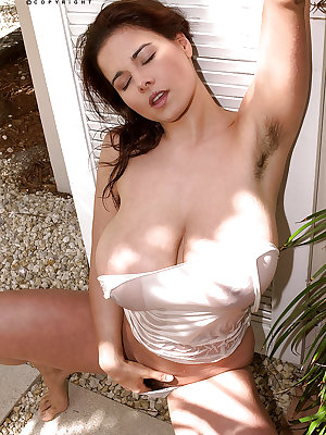 Wet solo girl Chloe Vevrier showing off huge MILF tits outdoors