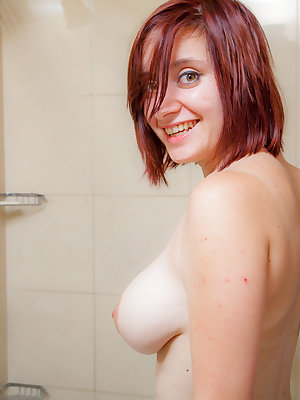 Busty horny amateur Chelsea Bell strips down to her sexy tattoos for a shower