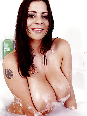 Solo girl Linsey Dawn McKenzie soaping up huge wet tits in bathtub