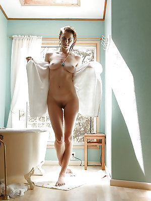 Super curvy redhead babe April Grantham taking a soothing bath