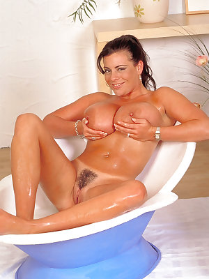 Solo girl Linsey Dawn McKenzie pours a jug f milk over her hooters in bathtub
