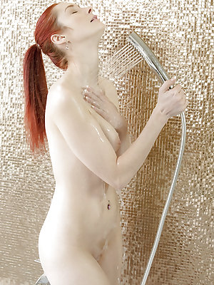 Natural European redhead Kattie Gold wetting perfect boobs in shower