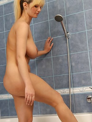 Older blond Vanessa Lovely takes her large natural tits to the shower