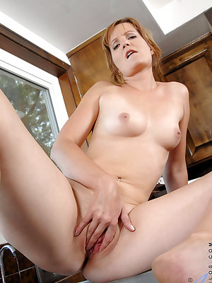 Middle-aged housewife Sadie masturbates with help from a pre-rinse faucet
