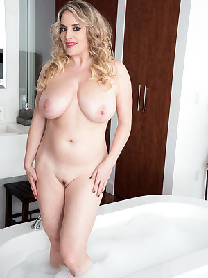 Blonde angel with big tits takes a bath and masturbates her glorious pussy