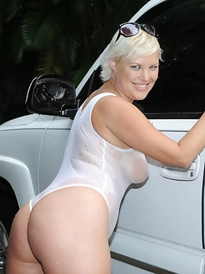 Chubby MILF Marilyn Mandala shows off her private parts in a see thru onesie